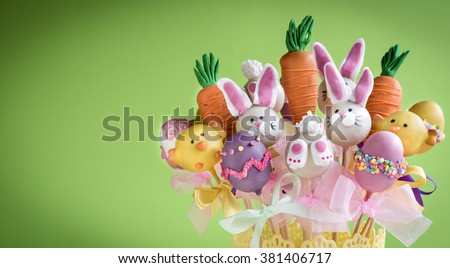 Easter cake pops concept on green background with copy space - stock photo