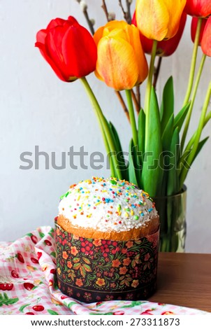 Easter cake with colorful topping on wood background - stock photo