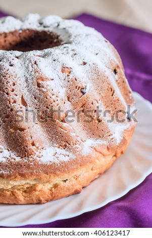 Easter cake with icing sugar and raisins - stock photo