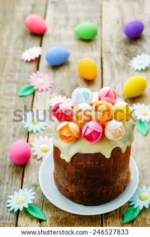 Easter cake with multicolored flowers on a wood background. tinting. selective focus - stock photo