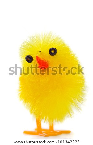 Easter chick. Cute yellow fluffy toy bird isolated on white - stock photo