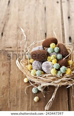 easter chocolate, egg, hand made, nest hay,celebration - stock photo