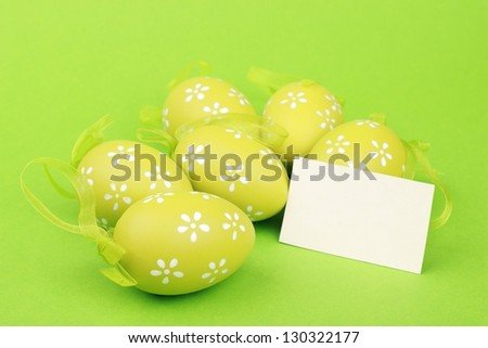Easter colored eggs and white spring tulips for greeting card - stock photo