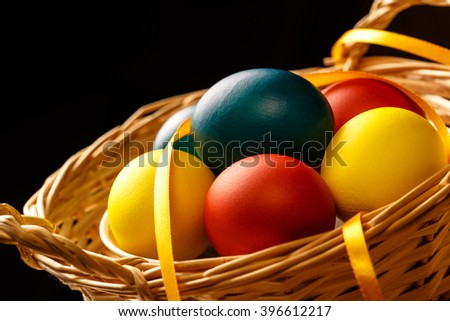 Easter colorful boiled eggs in basket closeup - stock photo