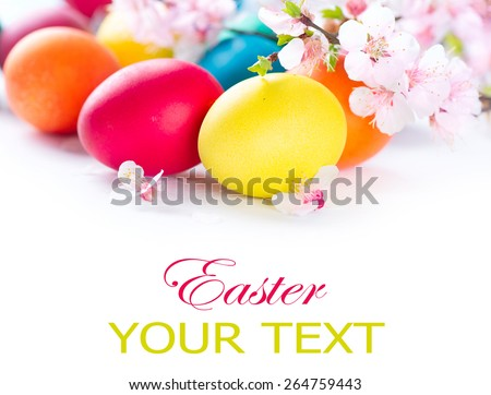 Easter. Colorful Easter eggs with spring blossom flowers isolated over white background. Colored Egg Holiday border art design - stock photo