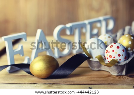 Easter composition flower and eggs on wooden background - stock photo