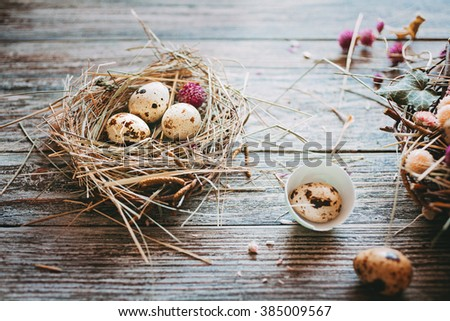 Easter composition of  Easter eggs in the nest on the old wooden background. Retro vintage style. Soft focus - stock photo