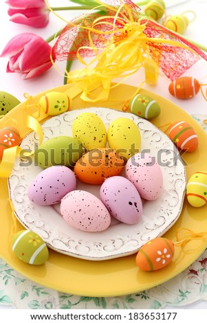 easter composition of easter eggs on plate - stock photo