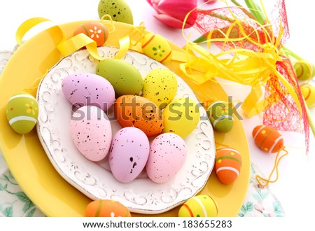 easter composition of eggs on plate - stock photo