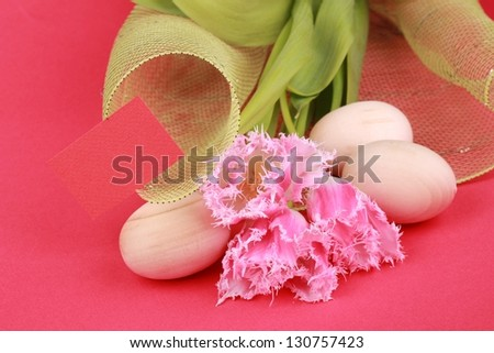 Easter composition on the topic/Easter egg and white tulip - stock photo