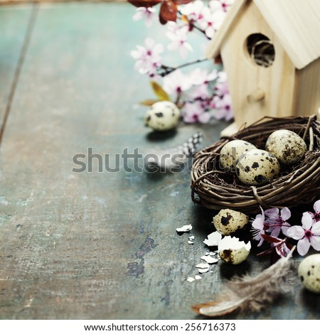 Easter composition with little birdhouse and Cherry Blossom branches - stock photo
