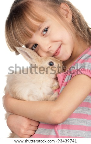 Easter concept image. Portrait of happy little girl with adorable rabbit over white background. - stock photo