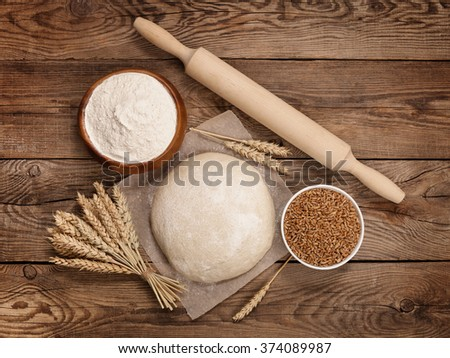 Easter concept. Wheat dough and ingredients for cooking on board. - stock photo