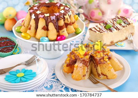 easter confectionery assortment with  marble ring cakes and cheesecake on festive table - stock photo
