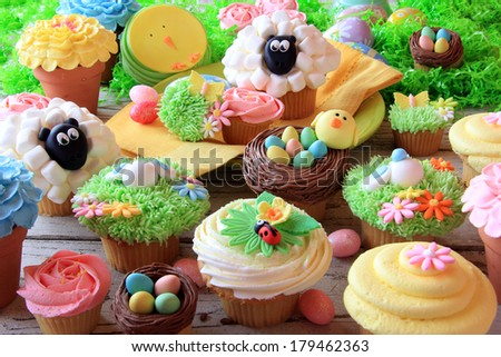 Easter cupcakes and Easter eggs display. Also available in vertical. - stock photo