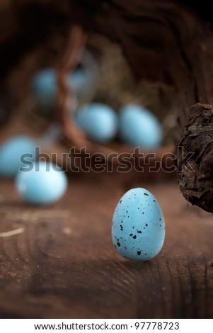 Easter decoration background with blue eggs on wooden background - stock photo