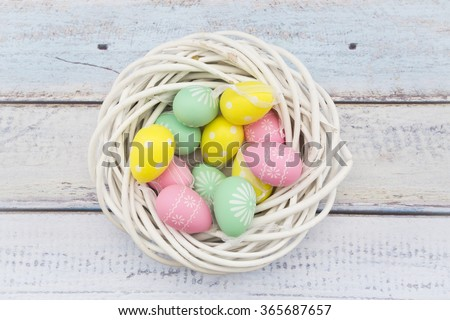 Easter decoration, Easter eggs, twigs on wood - stock photo