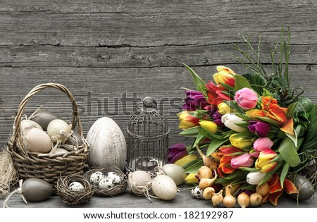 easter decoration with eggs and tulip flowers. nostalgic still life. vintage style picture - stock photo