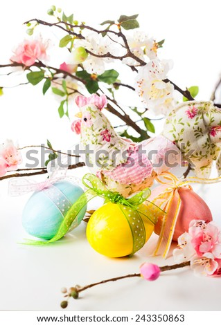 Easter decoration with eggs,chicken and spring flowers - stock photo