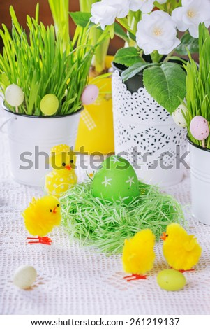 Easter decoration with green grass,flowers,eggs and chickens - stock photo