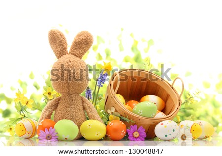 Easter decoration with rabbit and eggs - stock photo