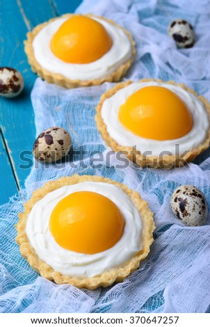 Easter Dessert, Tartlets with Cream and Apricot, selective focus - stock photo