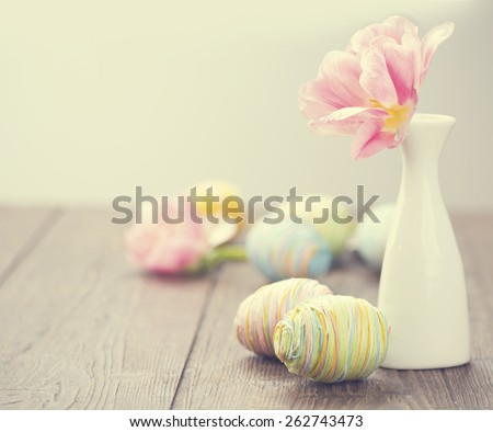 Easter. Easter Background. Beautiful Easter holiday photo decorated with colourful eggs and tulip flowers. Springtime. Invitation card design with space for your text - stock photo