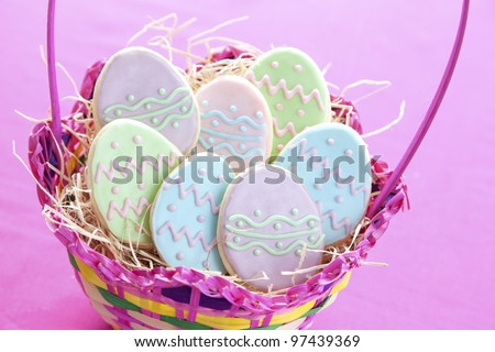 Easter egg cookies in basket - stock photo