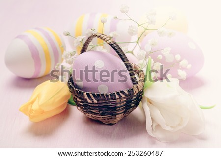 Easter egg in a basket - stock photo