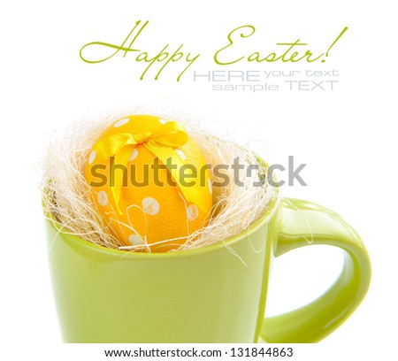 Easter egg in green cup on a white background - stock photo