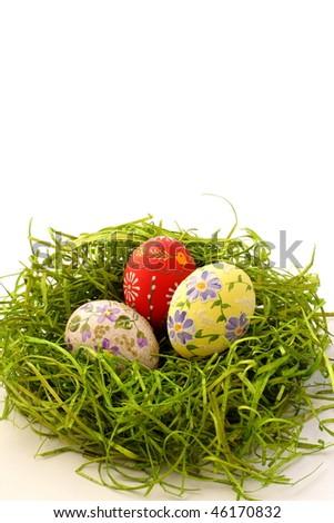 Easter egg on green grass background - stock photo