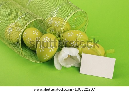 Easter egg with decorative ornaments and beautiful tulips with card for your text - stock photo