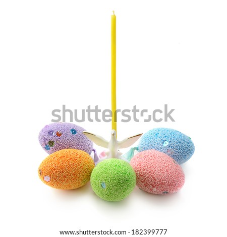 Easter eggs and a candlestick with a candle - stock photo