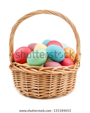 Easter eggs and basket isolated - stock photo