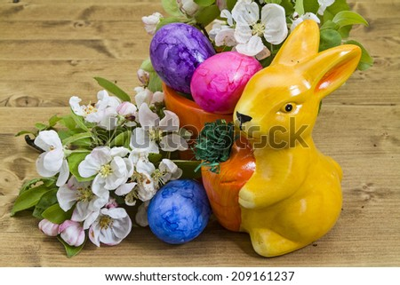 Easter eggs and blooming apple twigs - stock photo
