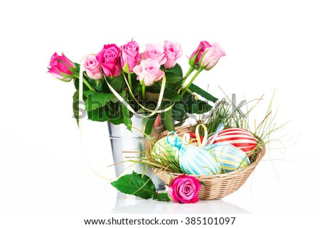 Easter eggs and flowers on white background - stock photo