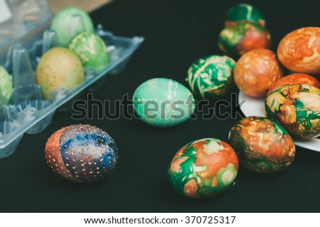 Easter eggs decorated with fresh grass and onion skins - stock photo