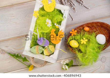 Easter eggs for easter nest on wooden background - stock photo