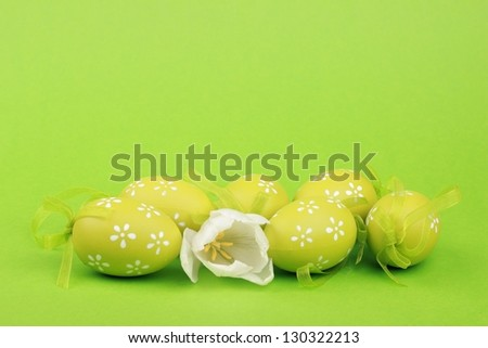 Easter eggs green on a green background - stock photo