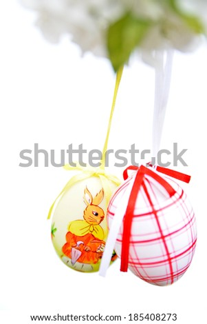 Easter eggs hanging on branch - white background - stock photo