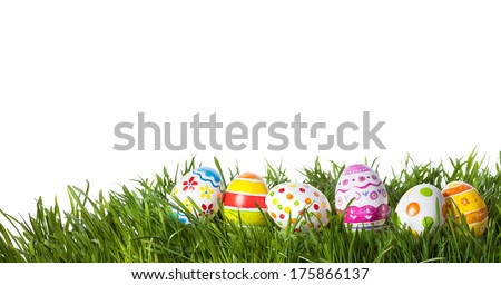 Easter eggs hiding in the grass  - stock photo