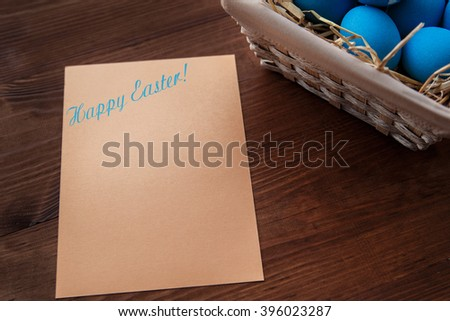 Easter eggs  in a basket on rustic wooden background, selective focus image, Happy Easter! - stock photo