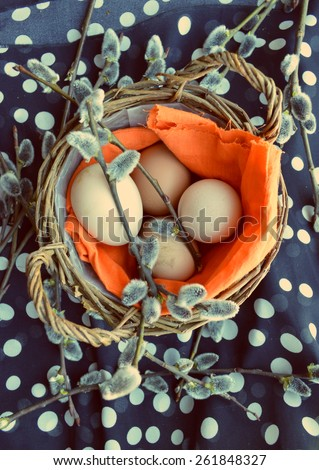 "Easter eggs in basket.Easter greeting card with words""happy Easter"",  pussy willow on tablecloth,black background - stock photo"