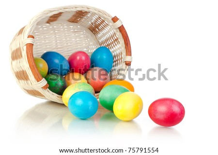 Easter Eggs in basket (isolated on white) - stock photo