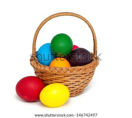 Easter eggs in basket over white - stock photo