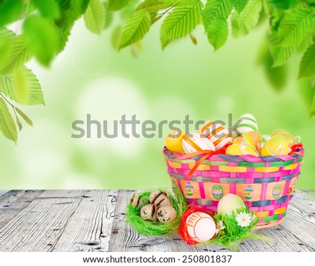 Easter eggs in colored basket - stock photo