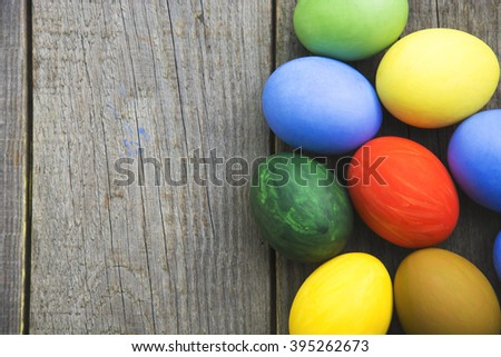 Easter eggs in nest on rustic wooden background, selective focus image, Card Happy Easter - space for text - stock photo