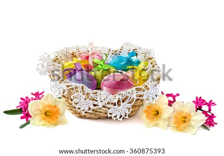Easter eggs in the basket, narcissus and hyacinth on white background - stock photo