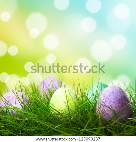 Easter eggs lying on the meadow - stock photo