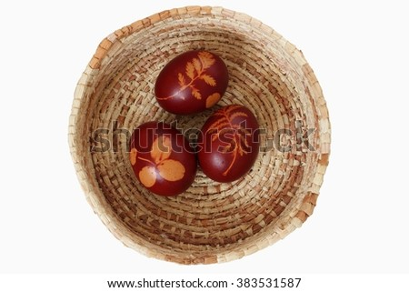 Easter eggs on a basket - in a traditional rustic style. Isolated. - stock photo